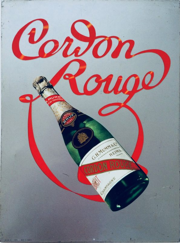 bottle of champage against silver background
